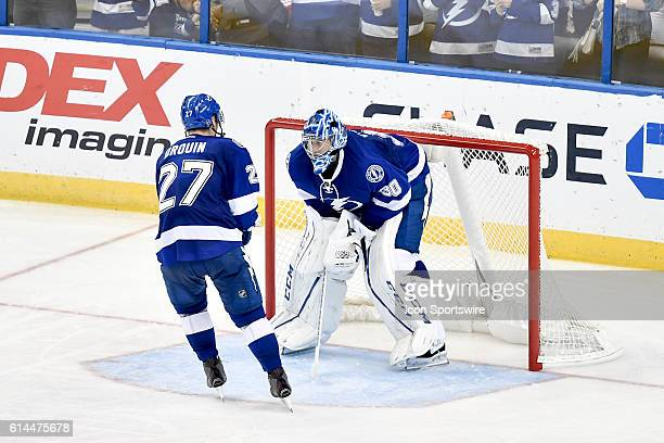 Tampa Bay Lightning left wing Jonathan Drouin scores and taps Tampa Bay Lightning goalie Ben Bishop during an National Hockey League game between the...