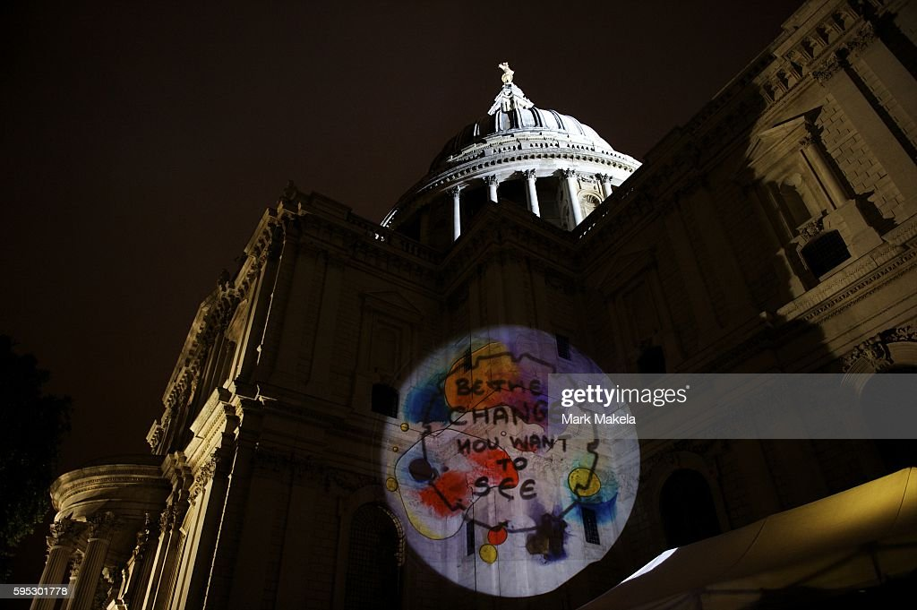 Oct 21 2011 London England UK Projections are spotlit on St Paul's Cathedral at the site of hundreds of protestors camping out as part of Occupy...