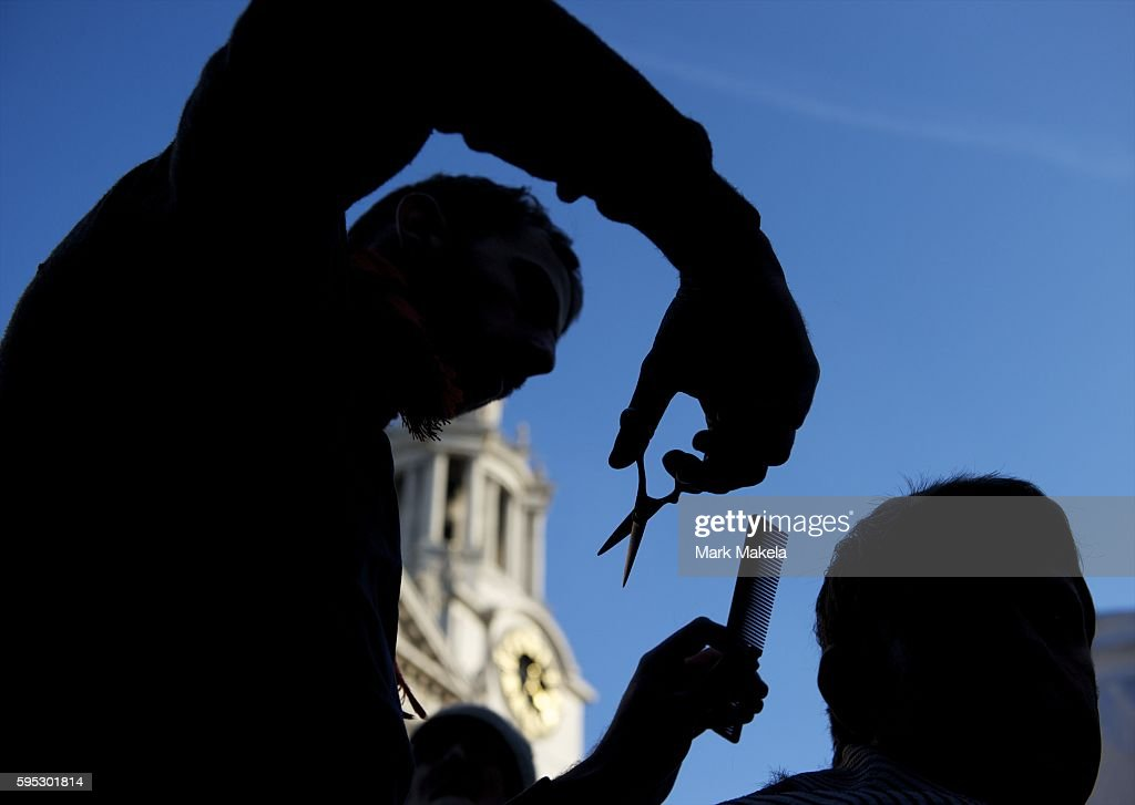Oct 22 2011 London England UK A barber cuts hair while engaging a crowd in banter Hundreds of 'Occupy London' protestors seized another camp at...