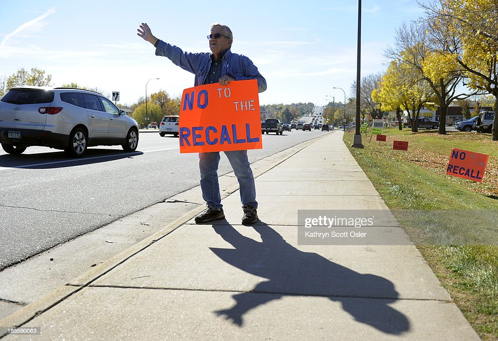 Dennis Larsen posted several 'no recall' signs and waved to passing cars along Wadsworth Blvd. Both sides of the effort to recall Sen. Evie Hudak from her seat in District 19 gather along Wadsworth Blvd. near W. 80th Ave. A small group supporting the recall gathered signatures from a small table along the street while a man opposed to the recall placed several signs and waved to drivers passing by.