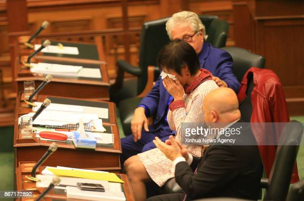 TORONTO Oct 26 2017 Soo Wong a member of Provincial Parliament of Canada's Ontario who tabled the motion wipes tears away during the debate period at...
