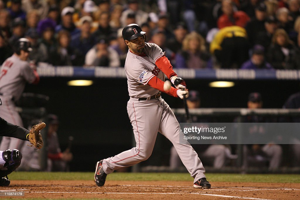 Oct 28 2007 Denver Colorado USA Boston Red Sox MIKE LOWELL takes a swing against the Colorado Rockies at Coors Field in Denver during game three of...