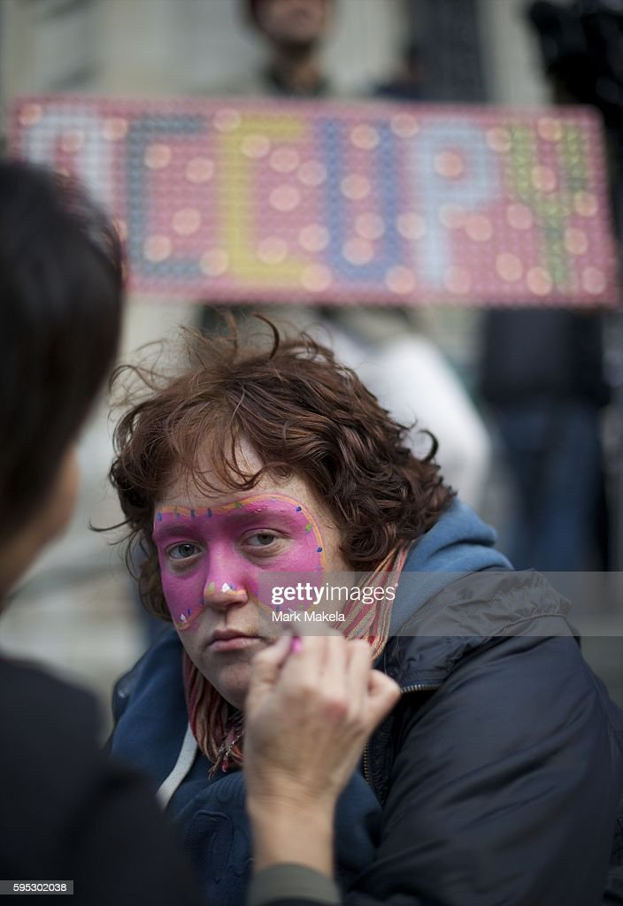 Oct 29 2011 London England UK JESS ELLIS has her face painted during a family fun day of 'Occupy London' as hundreds of protestors camp outside St...