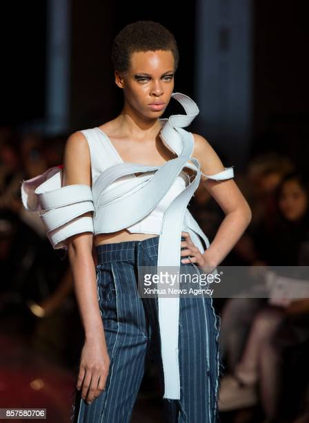 TORONTO Oct 4 2017 A model presents a creation designed by Ivan Liang of Seneca College during the Spring/Summer 2018 Toronto Women's Fashion Week in...