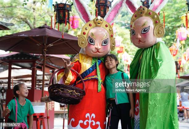 SHENZHEN Oct 4 2017 Children pose for pictures with actors at a theme park in Shenzhen City of south China's Guangdong Province Oct 4 2017 This...