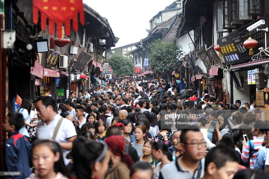 CHONGQING Oct 5 2015 Photo taken on Oct 5 2015 shows Ciqikou ancient town crowded with tourists in southwest China's Chongqing Municipality Ciqikou...