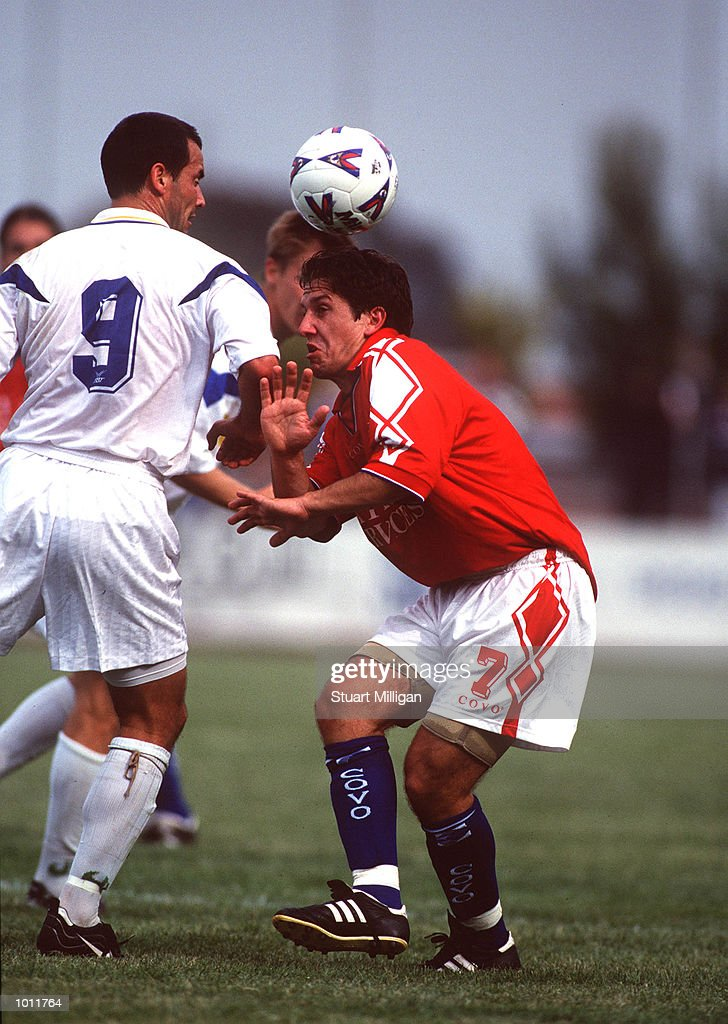 Mark Silic,#7 for the Melbourne Knights attempts to head the ball as his Brisbane opponent Paul Foster,#9 looks on during the N.S.L match played between The Melbourne Knights and the Brisbane Strikers at Knights Stadium, Melbourne, Australia. Brisbane defeated Melbourne Knights 1-0. Mandatory Credit: Stuart Milligan/ALLSPORT