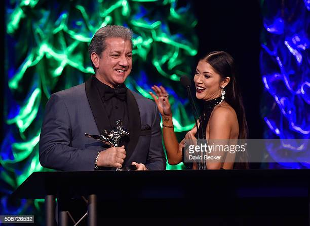 Octagon announcer Bruce Buffer and UFC Octagon Girl Arianny Celeste accept the Best Promotion of the Year award for UFC at the eighth annual Fighters...