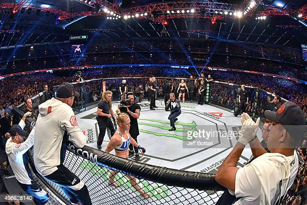 Octagon announcer Bruce Buffer introduces Holly Holm before facing Ronda Rousey in their UFC women's bantamweight championship bout during the UFC...