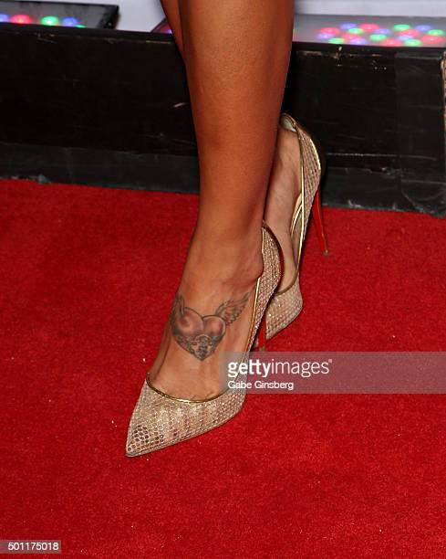 Octagon Girl and model Arianny Celeste shoes tattoo detail attends a UFC 194 after party at Hyde Bellagio at the Bellagio on December 12 2015 in Las...