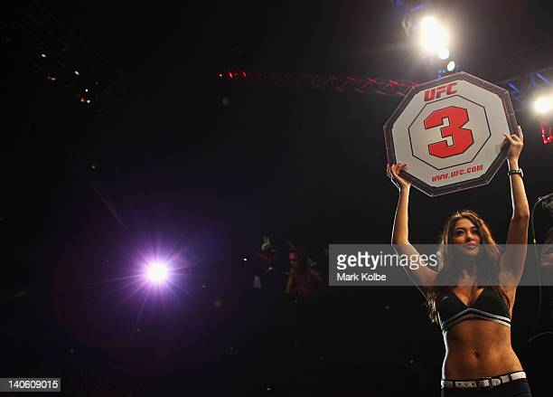 Octagon Girl Arianny Celeste holds up a round card during the UFC On FX middleweight bout between Andrew Craig and Kyle Noke at Allphones Arena on...