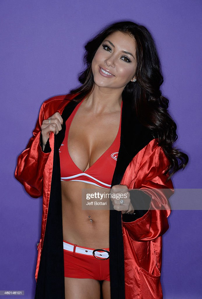 Octagon Girl <a gi-track='captionPersonalityLinkClicked' href=/galleries/search?phrase=Arianny+Celeste&family=editorial&specificpeople=4900711 ng-click='$event.stopPropagation()'>Arianny Celeste</a> poses for a portrait during the UFC 168 event at the MGM Grand Garden Arena on December 28, 2013 in Las Vegas, Nevada.