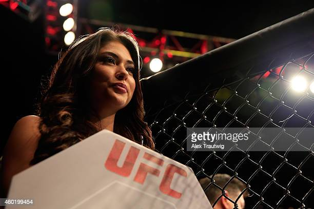 Octagon Girl Arianny Celeste signals the beginning of round one between Tony Ferguson and Abel Trujillo in their fight during the UFC 181 event at...