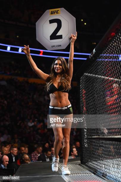 Octagon Girl Arianny Celeste signals the start of round two between Chris Weidman and Gegard Mousasi of the Netherlands in their middleweight bout...