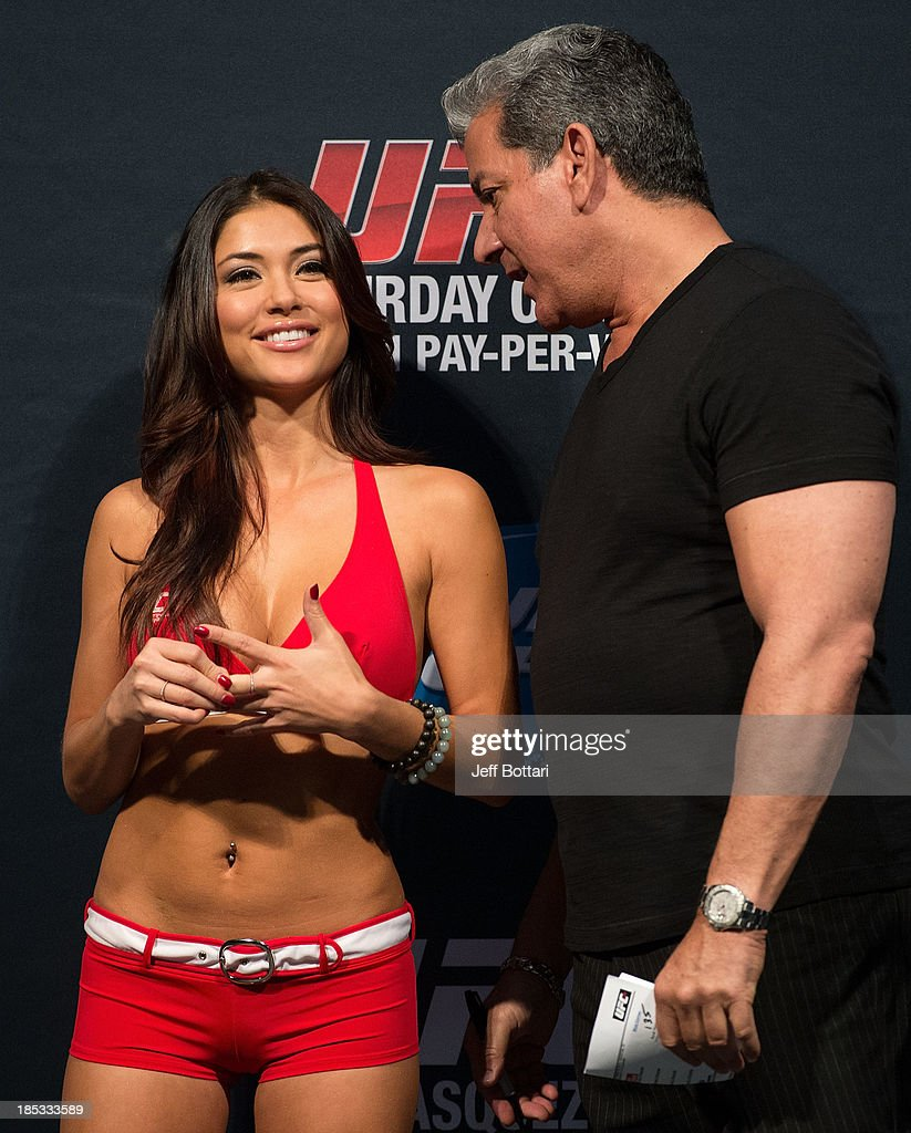 Octagon Girl Arianny Celeste (L) talks with UFC Octagon announcer Bruce Buffer on stage during the UFC 166 weigh-in at the Toyota Center on October 18, 2013 in Houston, Texas.