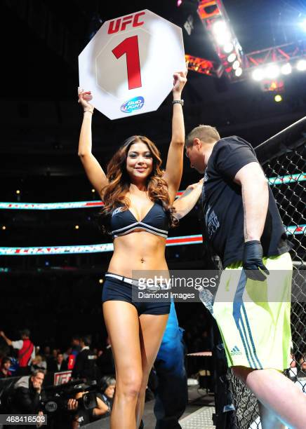 Octagon girl Arianny Celeste walks around the octagon inbetween rounds during UFC on Fox 10 Henderson v Thomson at United Center in Chicago Illinois