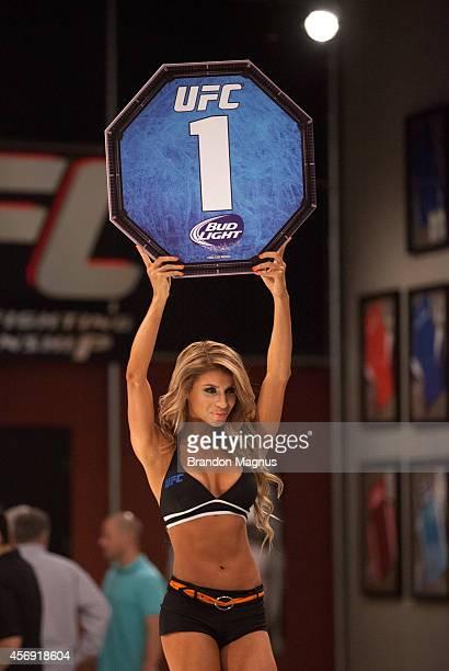 Octagon Girl Betzy Montero signals the first round between Team Velasquez fighter Marco Beltran and team Werdum fighter Guido Cannetti in their...
