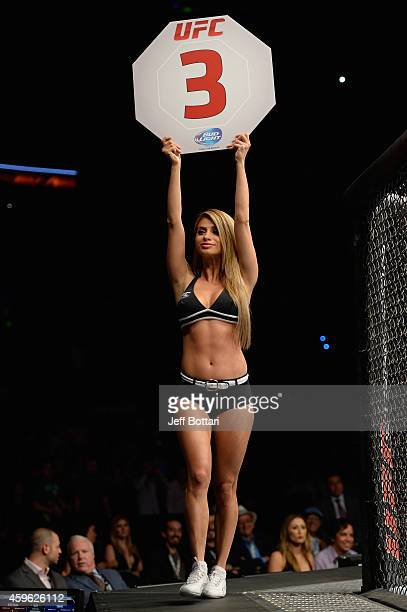 Octagon Girl Betzy Montero signals the start of round three between Marco Beltran and Marlon Vera in their bantamweight bout during the UFC 180 event...