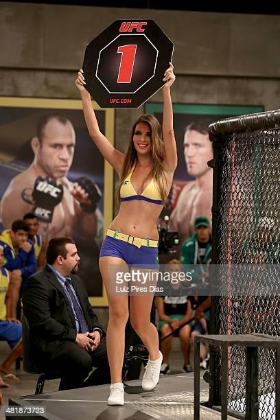 Octagon Girl Francine Pantaleao signals the start of round one between Team Wanderlei fighter Antonio Carlos Junior and Team Sonnen fighter Edgard...