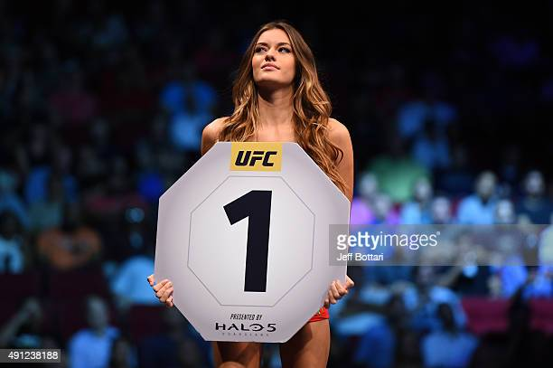 Octagon Girl Vanessa Hanson signals the start of round one between Alan Jouban and Albert Tumenov during the UFC 192 event at the Toyota Center on...