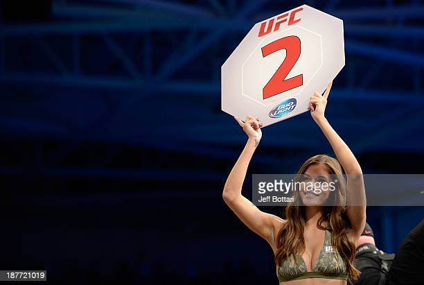 Octagon Girl Vanessa Hanson signals the start of round two between Ronny Markes and Yoel Romero in their UFC middleweight bout on November 6 2013 in...