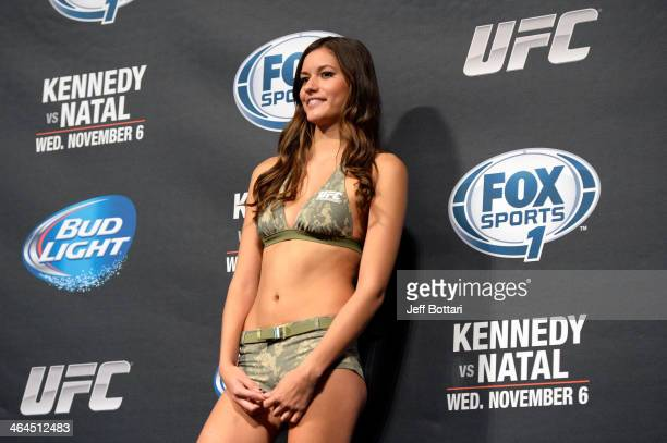 Octagon Girl Vanessa Hanson stands on stage during the UFC Fight For the Troops weighin at the Fort Campbell Sabre Air Field hanger on November 5...