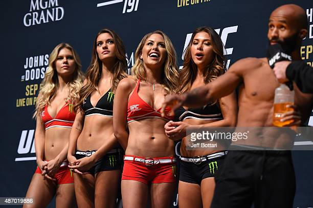 UFC Octagon Girls Chrissy Blair Vaness Hanson Brittney Palmer and Arianny Celeste stand onstage as UFC flyweight champion Demetrious Johnson...