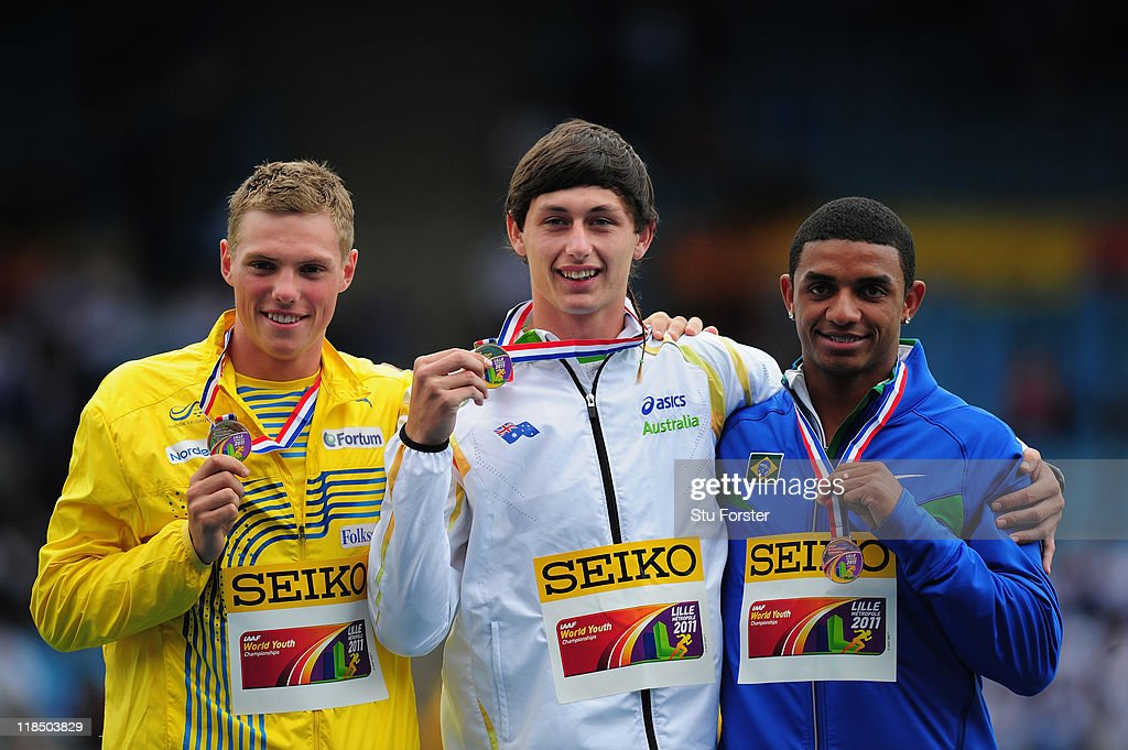 Octahon Gold medal winner Jake Stein of Australia (C) Silver medalist Fredrick Ekholm of Sweden (L) and bronze medal winner Felipe Dos Santos of Brazil hold up their medals during day three of the IAAF World Youth Championships at Lille Metropole stadium on July 8, 2011 in Lille, France.