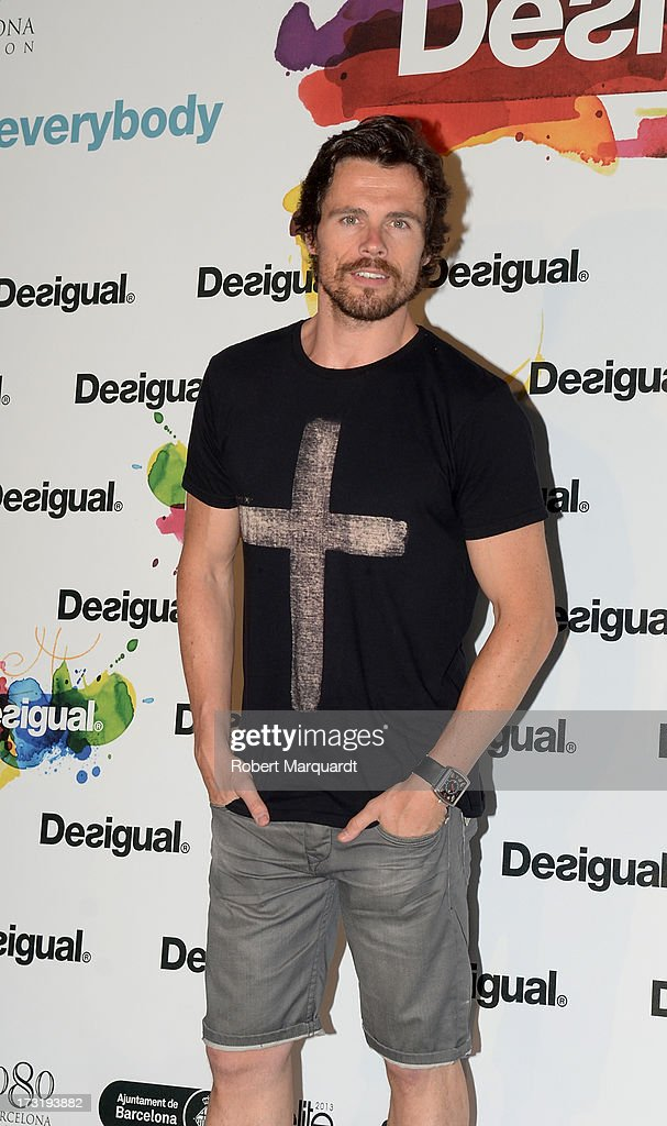Octavi Pujades poses during a photocall for Desigual's Spring-Summer 2014 Collection 'For Everybody: Sex, Fun & Love' during 080 Barcelona Fashion Week on July 9, 2013 in Barcelona, Spain.