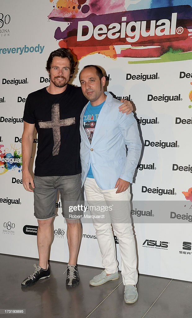 Octavi Pujades (L) poses during a photocall for Desigual's Spring-Summer 2014 Collection 'For Everybody: Sex, Fun & Love' during 080 Barcelona Fashion Week on July 9, 2013 in Barcelona, Spain.