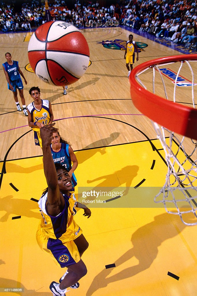 Octavia Blue #20 of the Los Angeles Sparks shoots against the Utah Starzz at Staples Center circa 1998 in Los Angeles, CA.