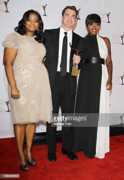 Octavia Spencer Tate Taylor and Viola Davis attend the 2012 Writers Guild Awards press room held at The Hollywood Palladium on February 19 2012 in...