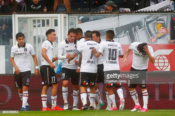 Octavio Rivero of Colo Colo celebrates with teammates after scoring the opening goal during a match between Colo Colo and Deportes Antofagasta as...