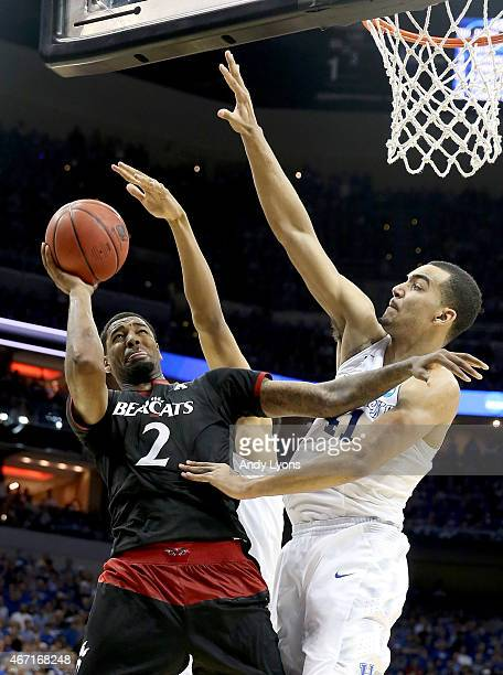 Octavius Ellis of the Cincinnati Bearcats drives to the basket against Trey Lyles of the Kentucky Wildcats during the third round of the 2015 NCAA...