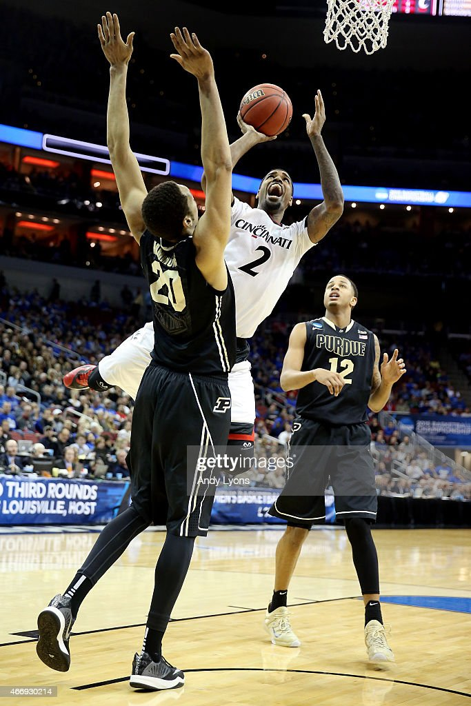 Octavius Ellis #2 of the Cincinnati Bearcats goes up for a shot as A.J. Hammons #20 of the Purdue Boilermakers defends during the second round of the 2015 NCAA Men's Basketball Tournament at the KFC YUM! Center on March 19, 2015 in Louisville, Kentucky.