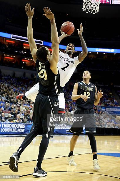 Octavius Ellis of the Cincinnati Bearcats goes up for a shot as AJ Hammons of the Purdue Boilermakers defends during the second round of the 2015...