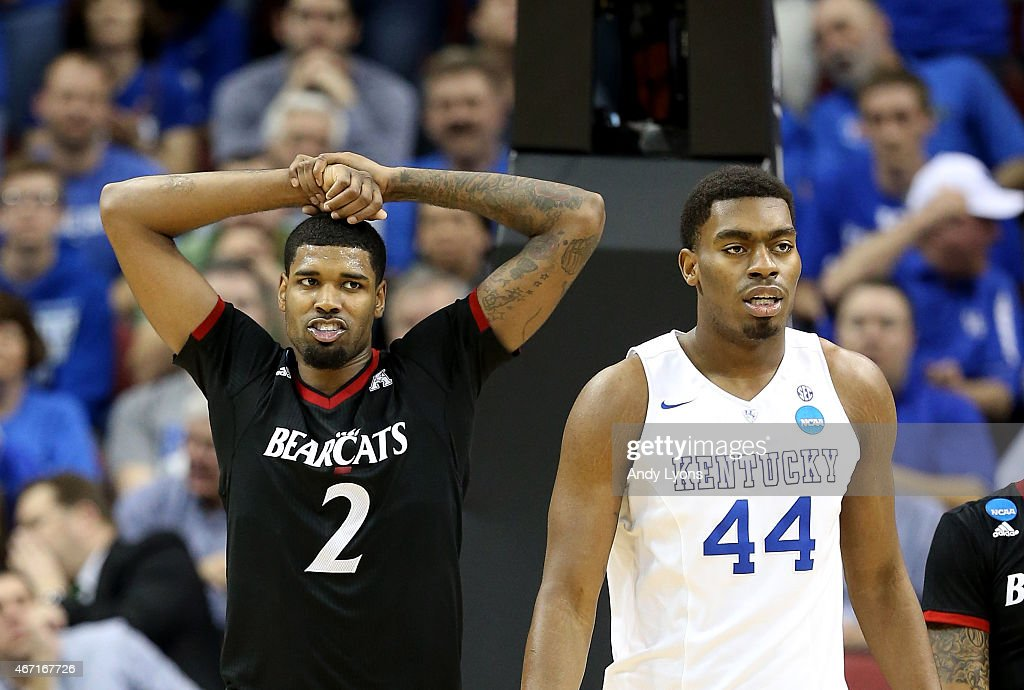 Octavius Ellis #2 of the Cincinnati Bearcats reacts as <a gi-track='captionPersonalityLinkClicked' href=/galleries/search?phrase=Dakari+Johnson&family=editorial&specificpeople=10784938 ng-click='$event.stopPropagation()'>Dakari Johnson</a> #44 of the Kentucky Wildcats watches on during the third round of the 2015 NCAA Men's Basketball Tournament at KFC YUM! Center on March 21, 2015 in Louisville, Kentucky.