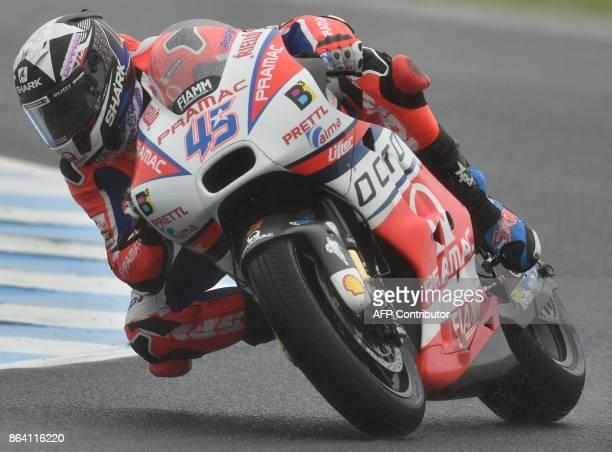Octo Pramac Racing team rider Scott Redding of Britain rides in the third practice session of the Australian MotoGP Grand Prix at Phillip Island on...