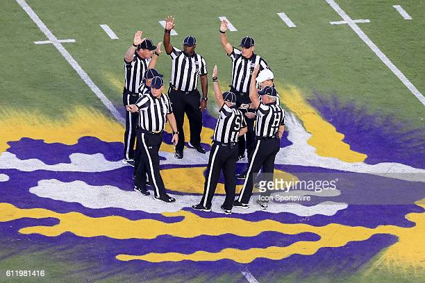 Referees gather at the 50 yard line during the game between the Missouri Tigers and the LSU Tigers at Tiger Stadium in Baton Rouge LA LSU Tigers...