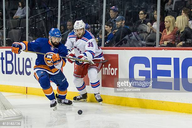 New York Islanders Defenseman Nick Leddy and New York Rangers Left Winger Nicklas Jensen chase after the puck during the third period of a preseason...