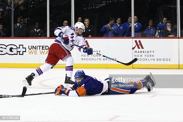 New York Islanders Defenseman Nick Leddy slides across the ice to block a shot by New York Rangers Center JT Miller during the first period of a...