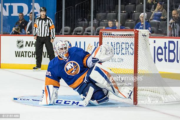 New York Islanders Goalie JeanFrancois Berube dives for a puck during the third period of a preseason NHL game between the New York Rangers and the...