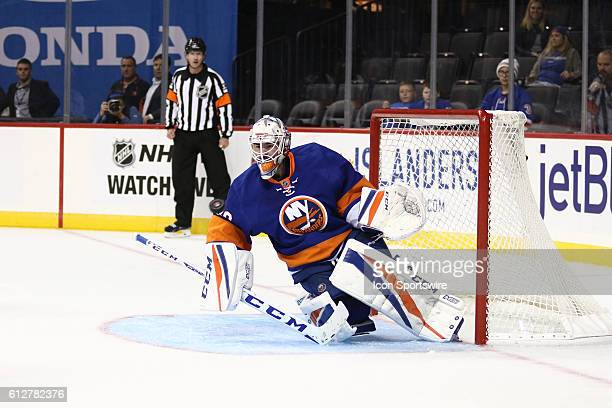 New York Islanders Goalie JeanFrancois Berube stares down a shot on net that finds its way into the net for a Rangers goal during the third period of...