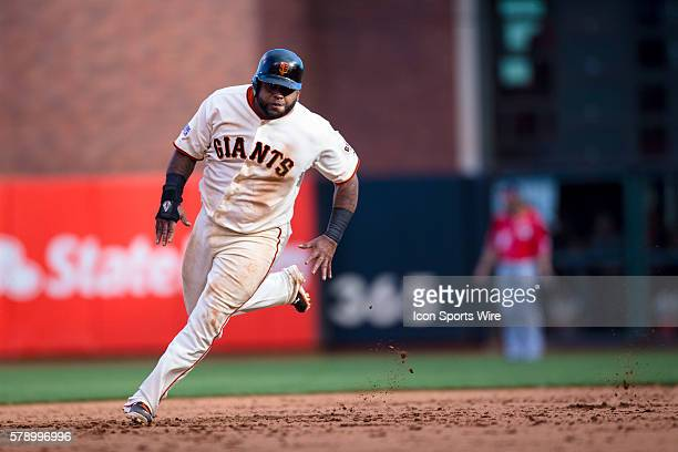 San Francisco Giants third baseman Pablo Sandoval beds to third base in the ninth inning during game 3 of the National League Division Series between...