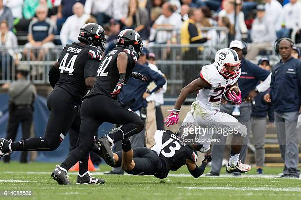 Cincinnati Cornerback Grant Coleman dives to tackle UConn Running Back Arkeel Newsome during the second half of a NCAA football game between AAC...