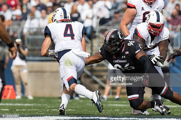 Cincinnati Defensive Tackle Cortez Broughton tackles UConn Quarterback Bryant Shirreffs during the first half of a NCAA football game between AAC...