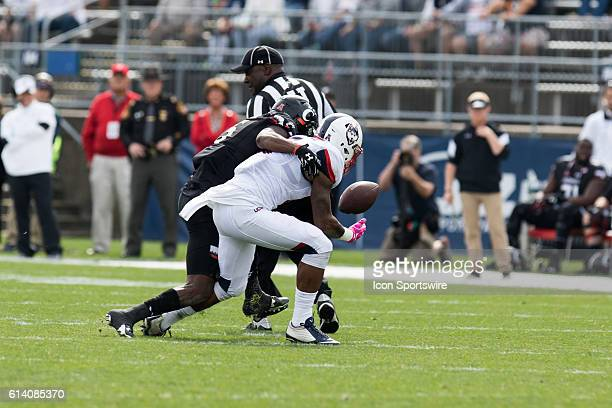 Cincinnati Running Back Taylor Boose hits UConn Wide Receiver Noel Thomas Jr as Thomas tries to make a catch during the first half of a NCAA football...