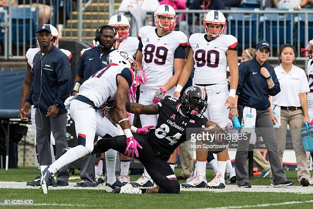 Cincinnati Wide Receiver Nate Cole is able to handle the ball as he goes to the ground during the first half of a NCAA football game between AAC...