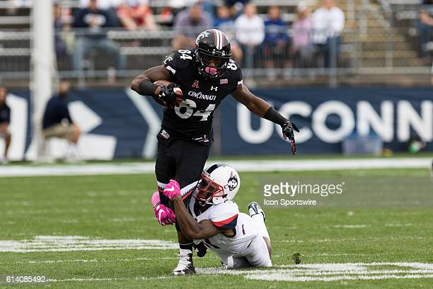 UConn Cornerback Jamar Summers tackles Cincinnati Wide Receiver Nate Cole during the second half of a NCAA football game between AAC rivals the...