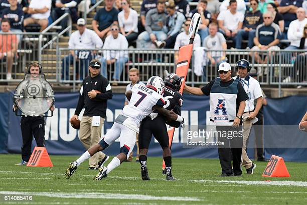 UConn Cornerback John Green forces Cincinnati Wide Receiver Jerron Rollins out of bounds during the first half of a NCAA football game between AAC...